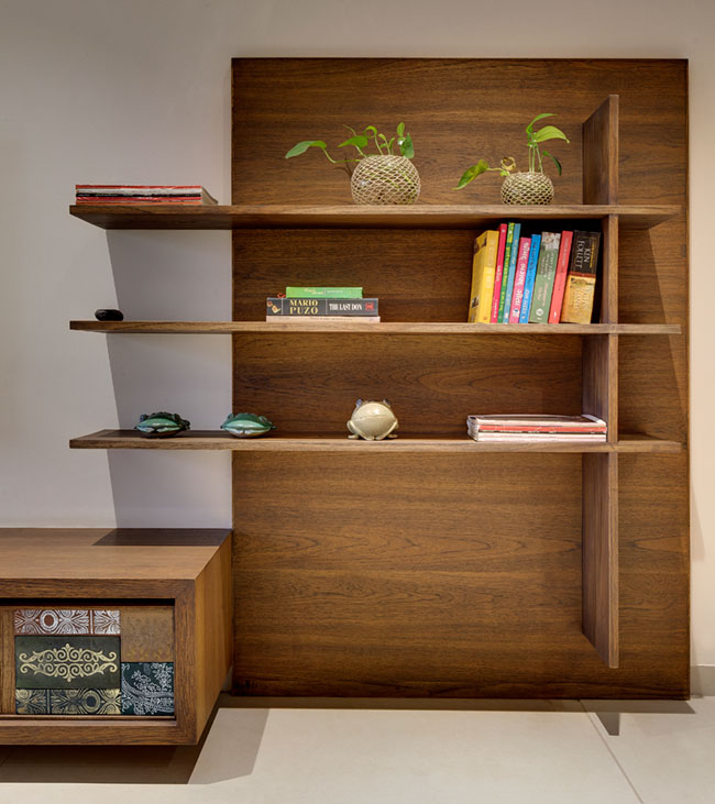 Indian design style: A beautiful wood clad TV unit with inlay tiles