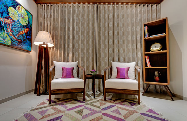 A reading nook in the master bedroom of a show apartment designed by VPA