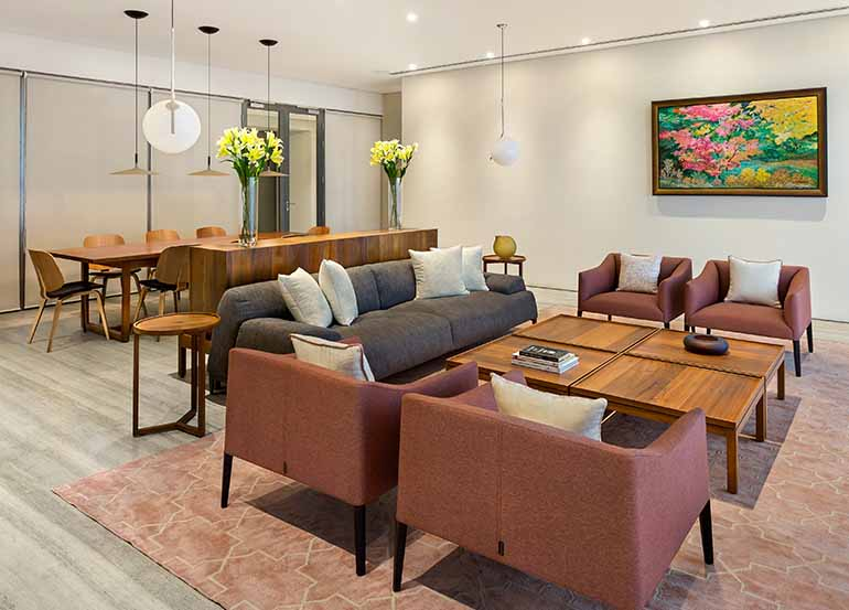 An expansive living-dining space anchors the kitchen and utilities on one side to the three bedrooms on the other.