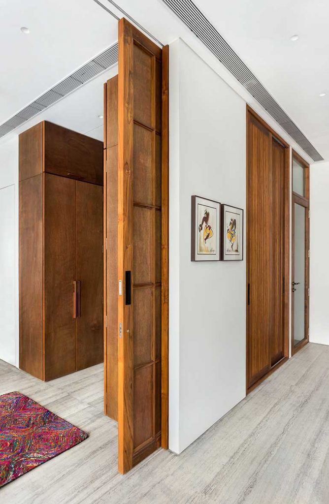 A set of sliding partitions allow for this room to be combined with the master bedroom when the clients do not have guests staying with them.