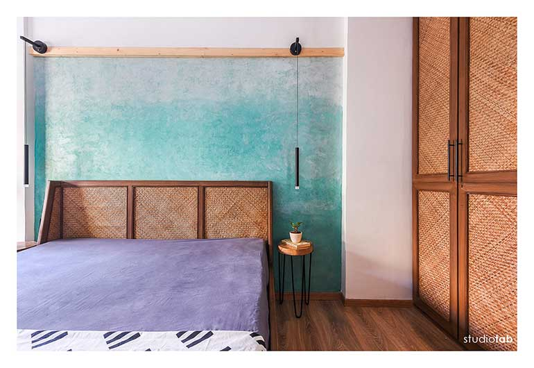 An ombre blue wall in the master bedroom -a DIY experiment that became a stunner using lime pigments.