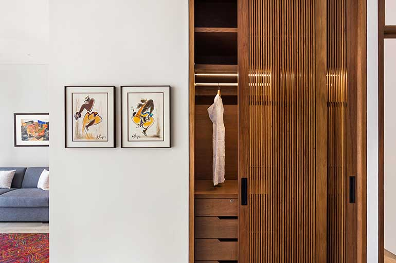 The dress section of the bedroom features a ribbed-n-paneled door.