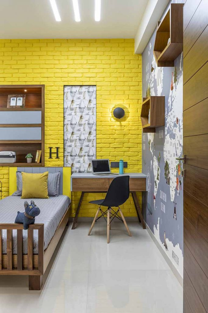 The bold yellow brick cladding wall is made of flex stone. The bright color brings in cheer to the kids room.