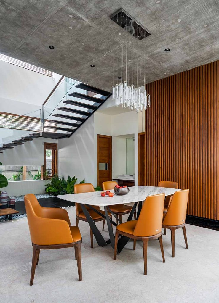 Dining room with exposed concrete ceiling.