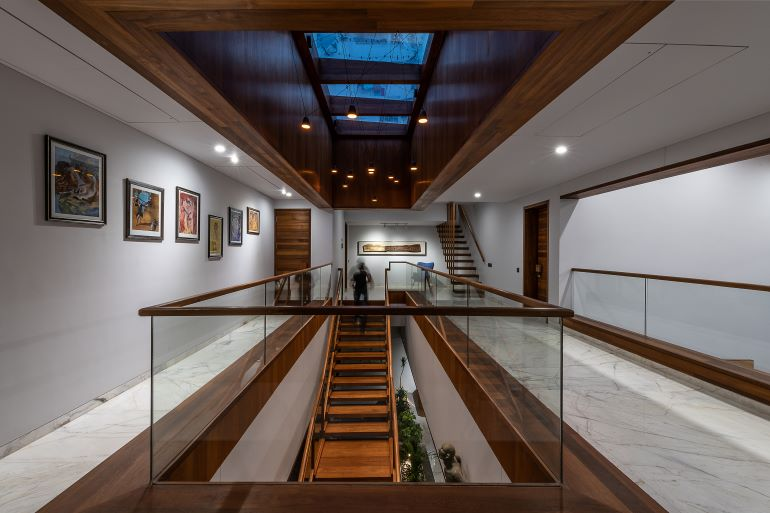 A narrow passage wall on the landing made interesting by transforming it into a gallery wall.