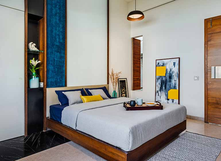 Master bedroom in royal blue accents. Vastu shastra for bedroom.