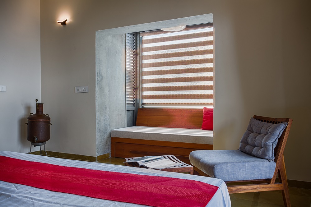 The master bedroom on the first floor with a window seat.