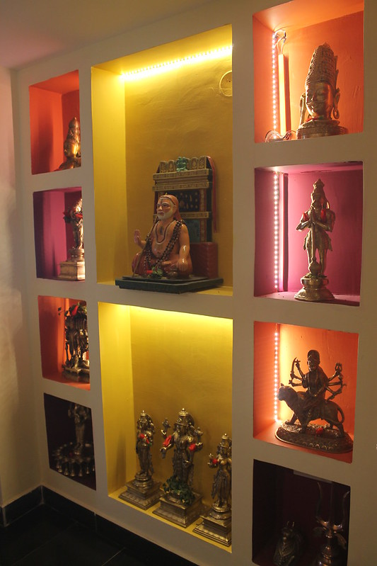 Wall niches with backlit LEDs in a pooja room