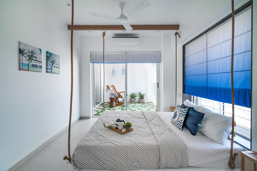 This bedroom open up in the balcony that is also accessible from the living room.