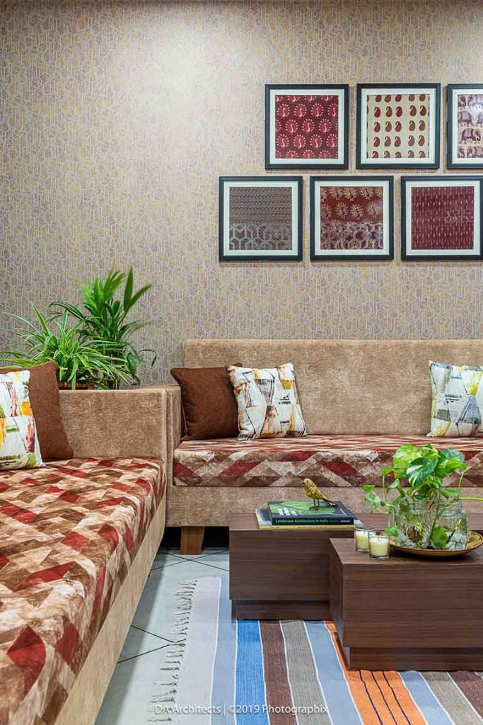 A gallery wall of block printed textiles is the focal point on the accent wall in the living room.