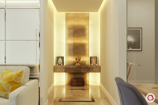 A small mandir design created in a niche between the foyer and the living room of an apartment