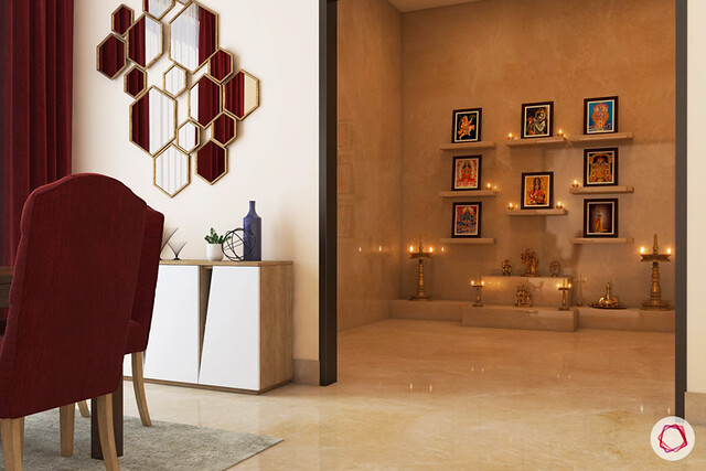 A traditional pooja room with separate entry and wall shelves to place frames of gods and goddesses. A simplistic design in marble flooring and platform to light lamps.