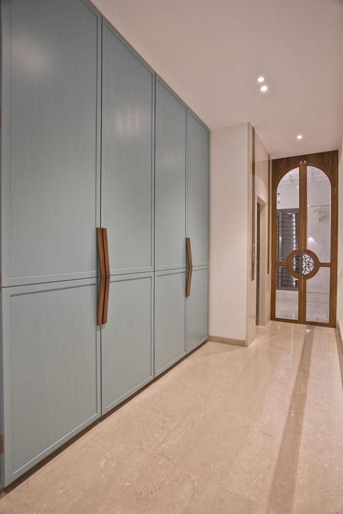 A walk-in closet in mint blue.