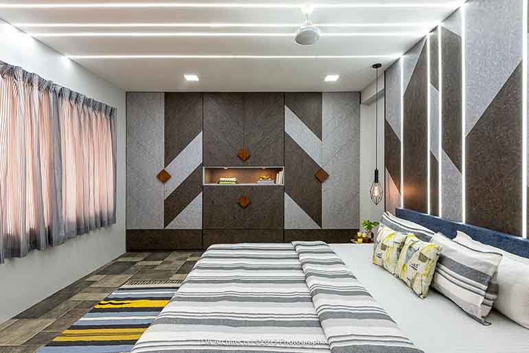 The large wardrobes in the master bedroom are designed in such a way that gives an effect of a feature wall & breaks the monotony of the typical wardrobe designs.