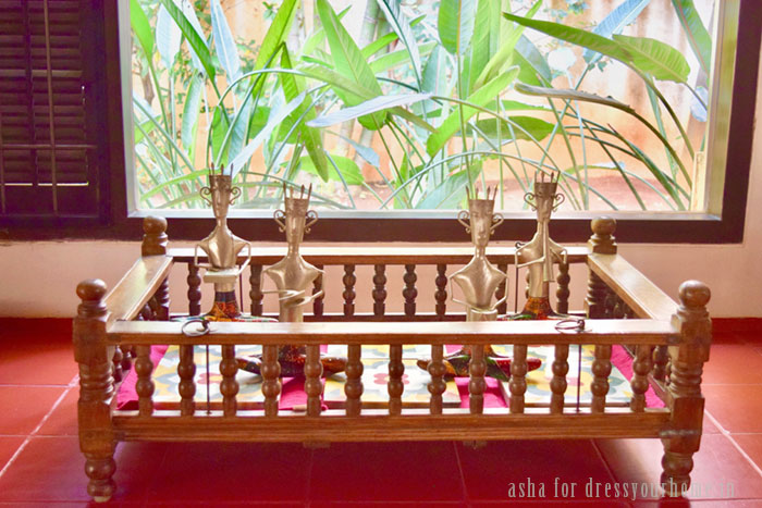 An old wooden cradle used as a display table for their collectibles - metal musicians. Athangudi tiles bought during a memorable trip to Karaikudi serves as the base.