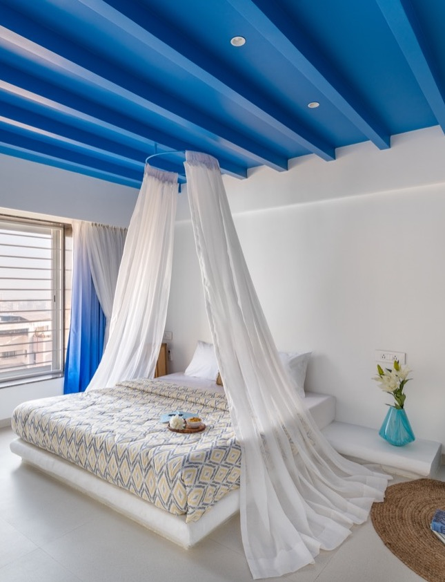 The canopy above the bed lends a romantic and dramatic effect to the space making it feel even more vacation like. Designed by Pune based interior design firm Between Walls.