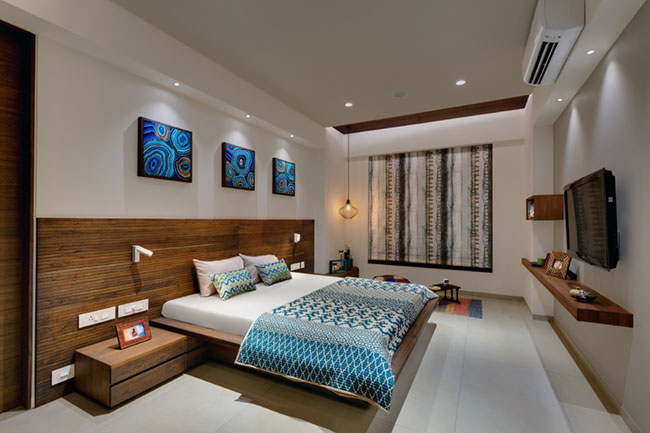 A tastefully done bedroom by Vipul Patel Architects in a sample apartment