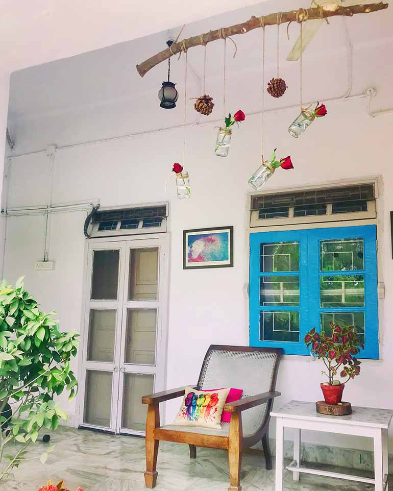 Rental home budget decorating ideas - The porch at Vibhuti's home. Decor Tip: This is the porch area of my house. DIY- The hanging bottle is a DIY, made out of mayonnaise bottles, rope and a tree stem. I also painted the windows blue, to give a highlighted effect to the porch.