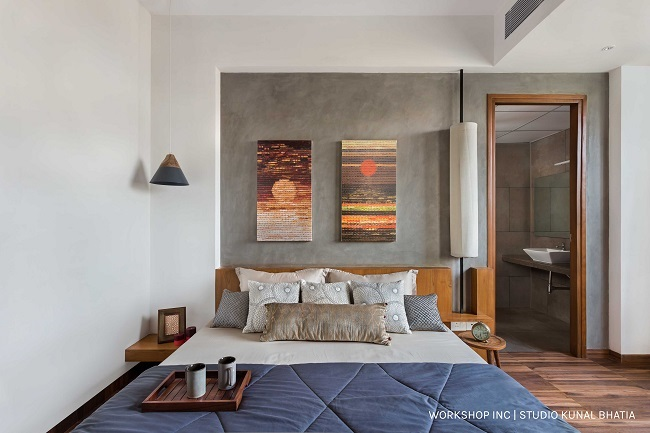 900 sq.ft apartment in Bangalore fits in a lot. Abstract art, minimalist lamps, and grey walls complete this Scandi style bedroom.