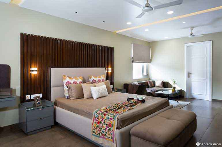 A brown and beige bedroom designed by 39 Design Studio in Gurgaon.