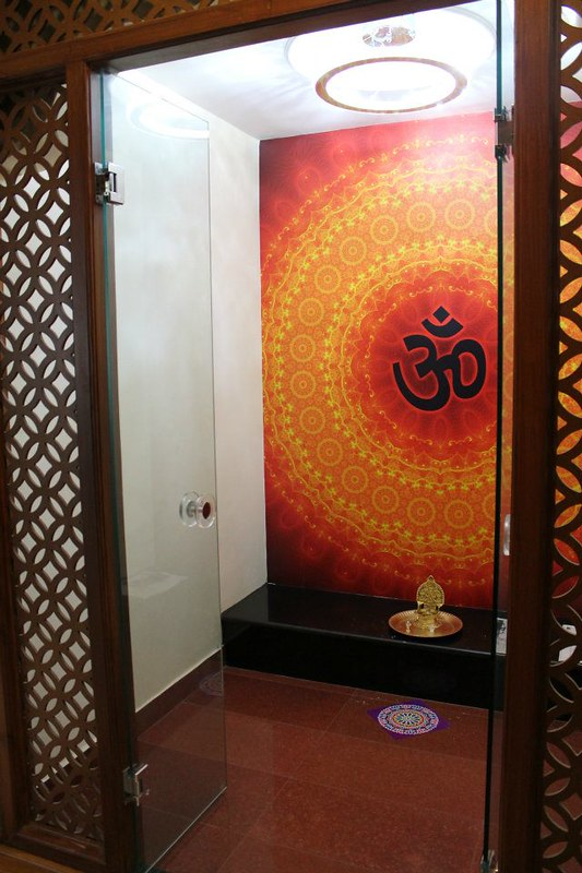 CNC cutting and glass door with red oxide flooring pooja room design