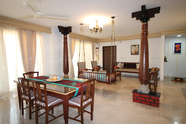 Chettinad architecture insipred apartment with wooden pillars and a swing