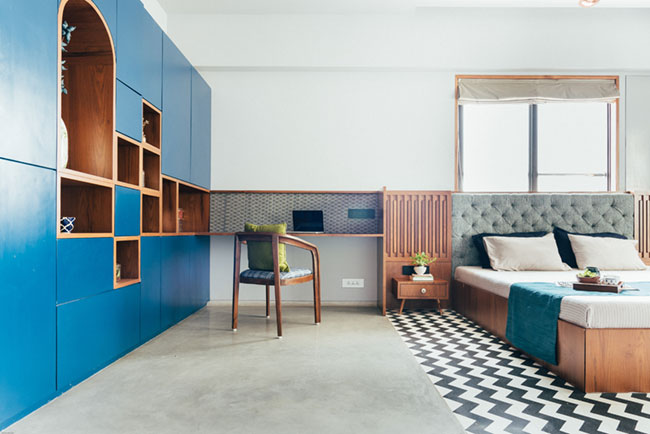 Chevro pattern terrazzo and IPS flooring makes this bedroom a sight for the sore eyes.