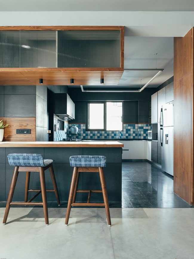 an open kitchen with bar style fixed dining
