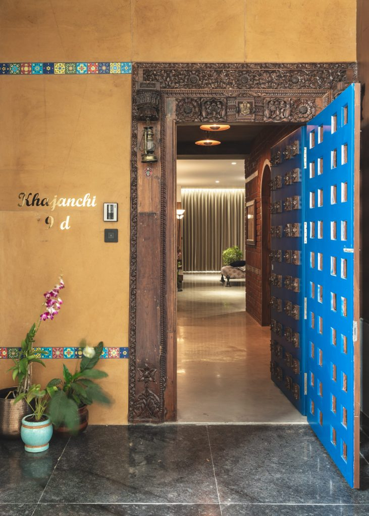 A beautifully crafted main door for an apartment in Surat