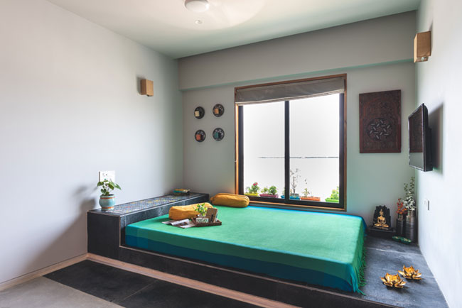 A minimalist wooden cubic bed