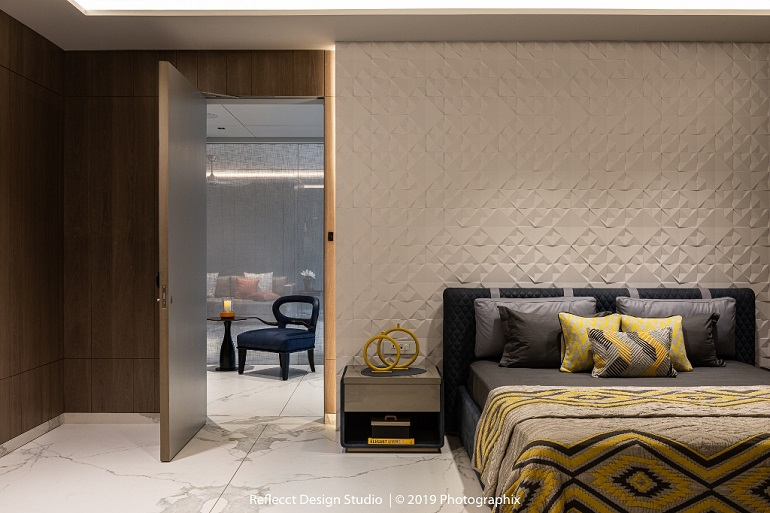The much in trend 3D Patterned wall forms the accent wall in this bedroom.