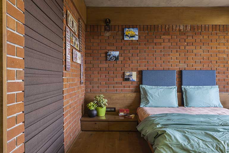 The brick walls are carried through the bedrooms as well. Here the flooring transitions to a wooden flooring lending it more warmth.