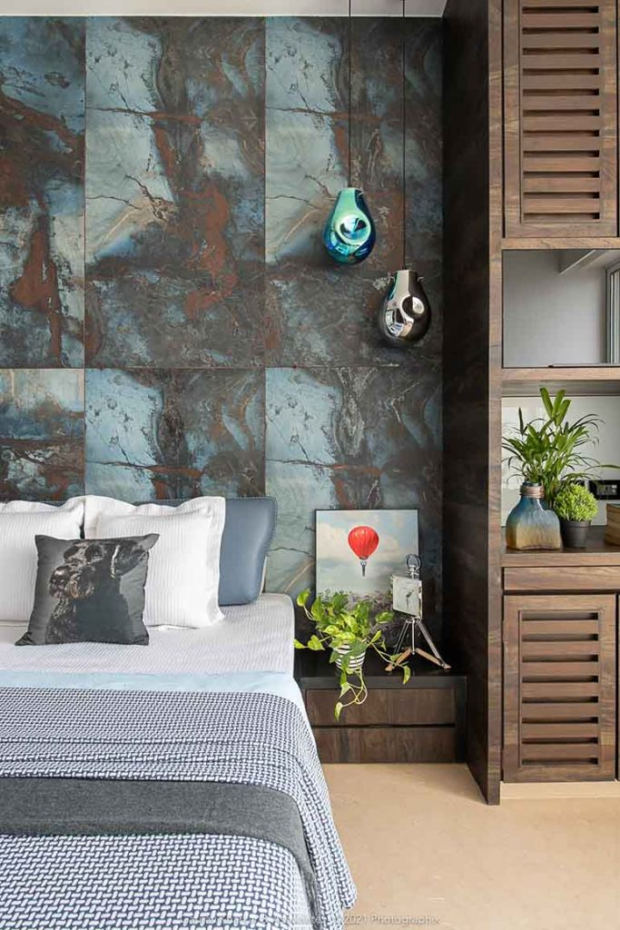A blue stone finished backdrop is the headboard in the son's bedroom.