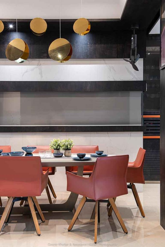 Dining has a color theme of orange, black and white.  The dining room has a peek a boo kitchen window with automised roller blinds for a better serving access from kitchen to dinning area and vice versa.