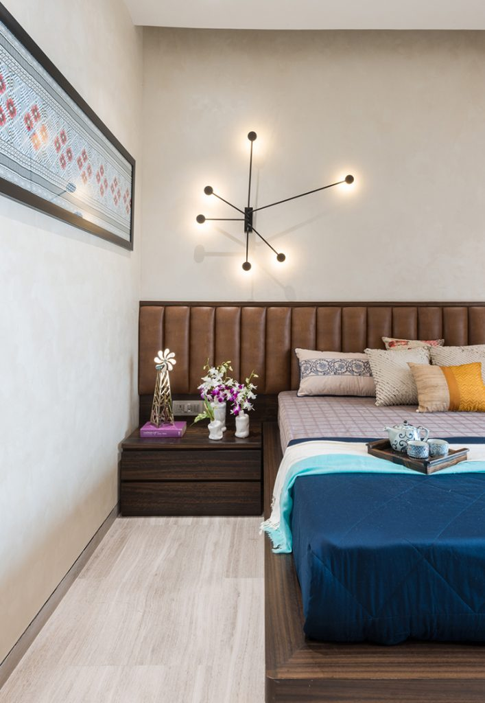 The parent's room has a neutral earthy colour palette; the wardrobes are highlighted in leather balanced by the fluted leather headboard.