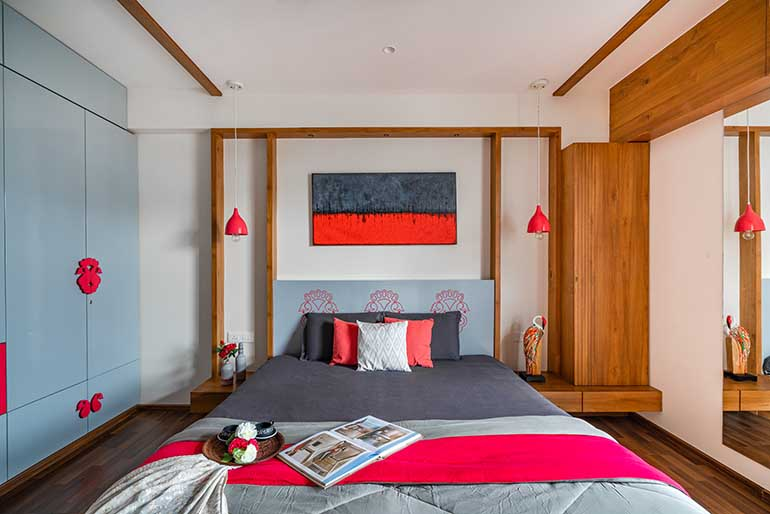 Gray and red master wardrobe. A black and red painting hangs behind the bed.
