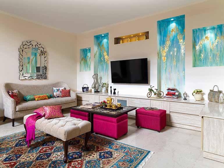 Hand painted wall niches in turquoise color with gold foil bring in colour to the living space.