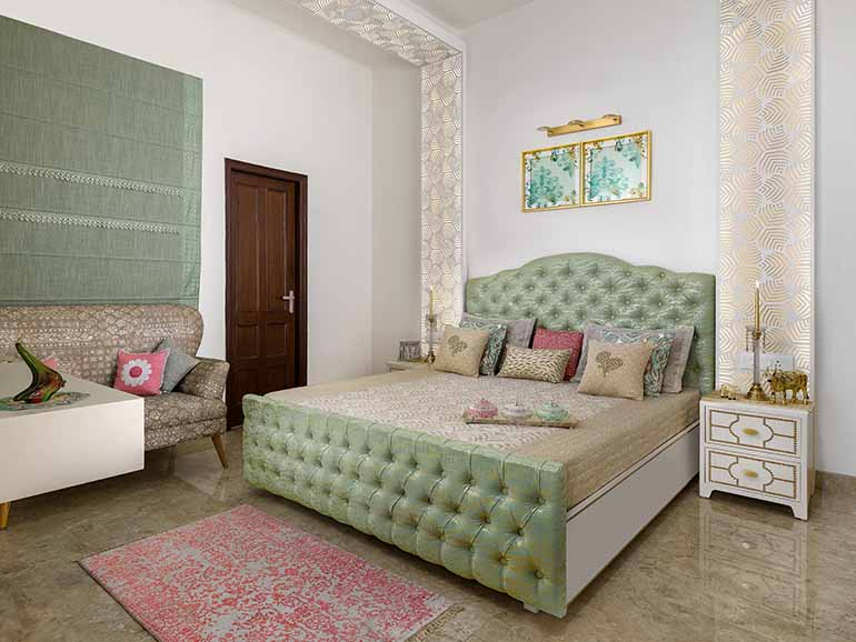 Mother's bedroom in pastel shades of green, and pink with gold tones.