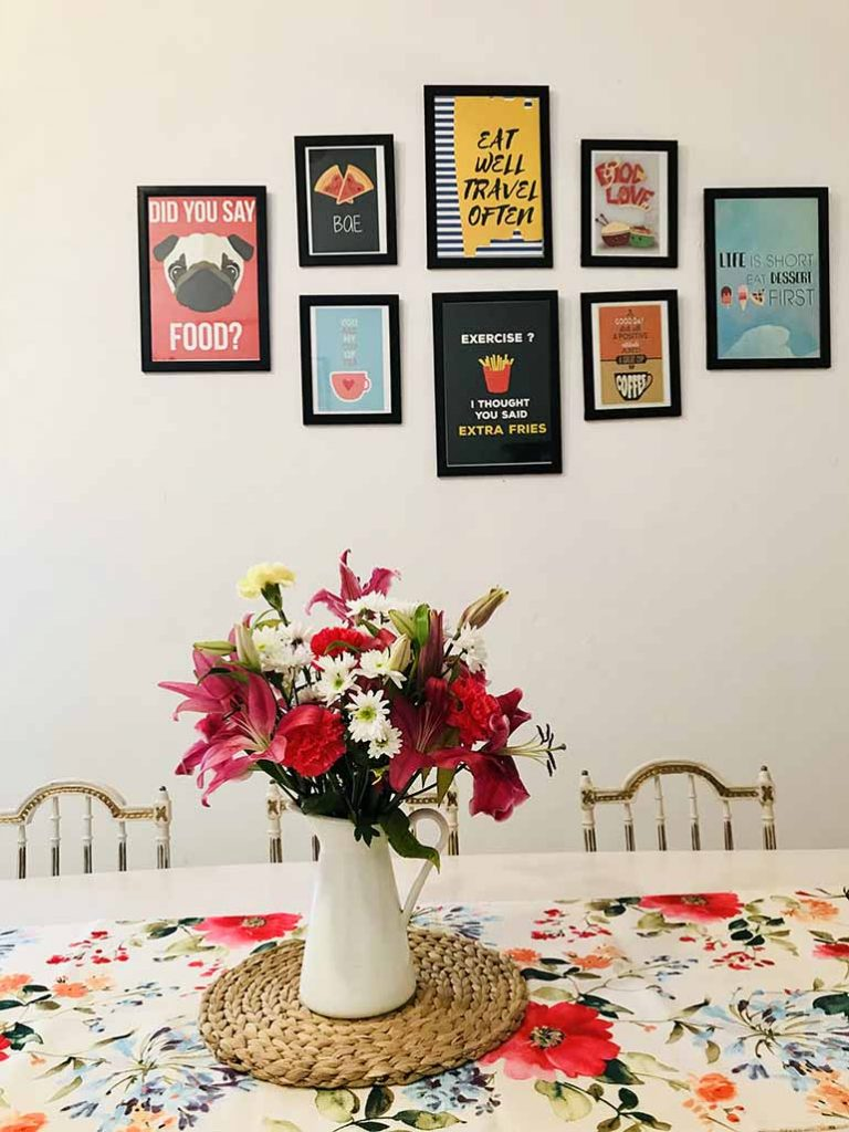 The posters are from PosterGuy (framed as wall frames). The vase & mat is from Ikea Hyderabad and the runner is a left out piece from a local cloth shop, stitched into a runner.