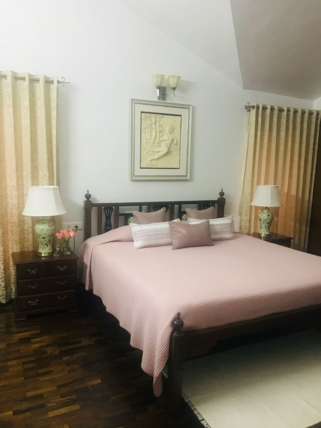 Master bedroom in pastel tones from a traditional South Indian home