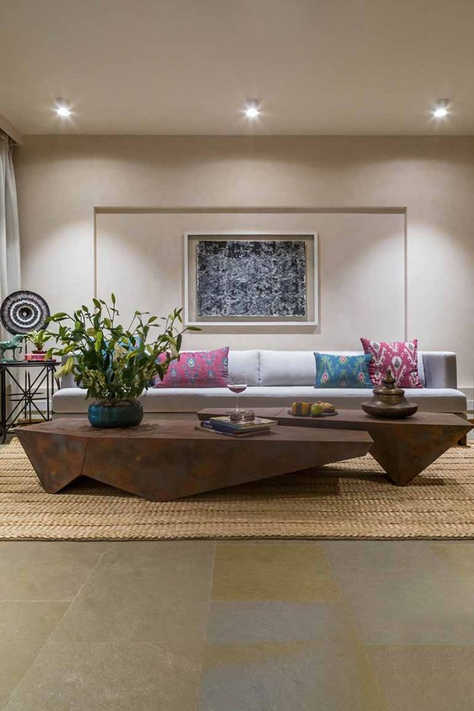 The dhurrie in the living room is  from Jaipur Rugs.  Art work is an ink on handmade paper by Namita Shah