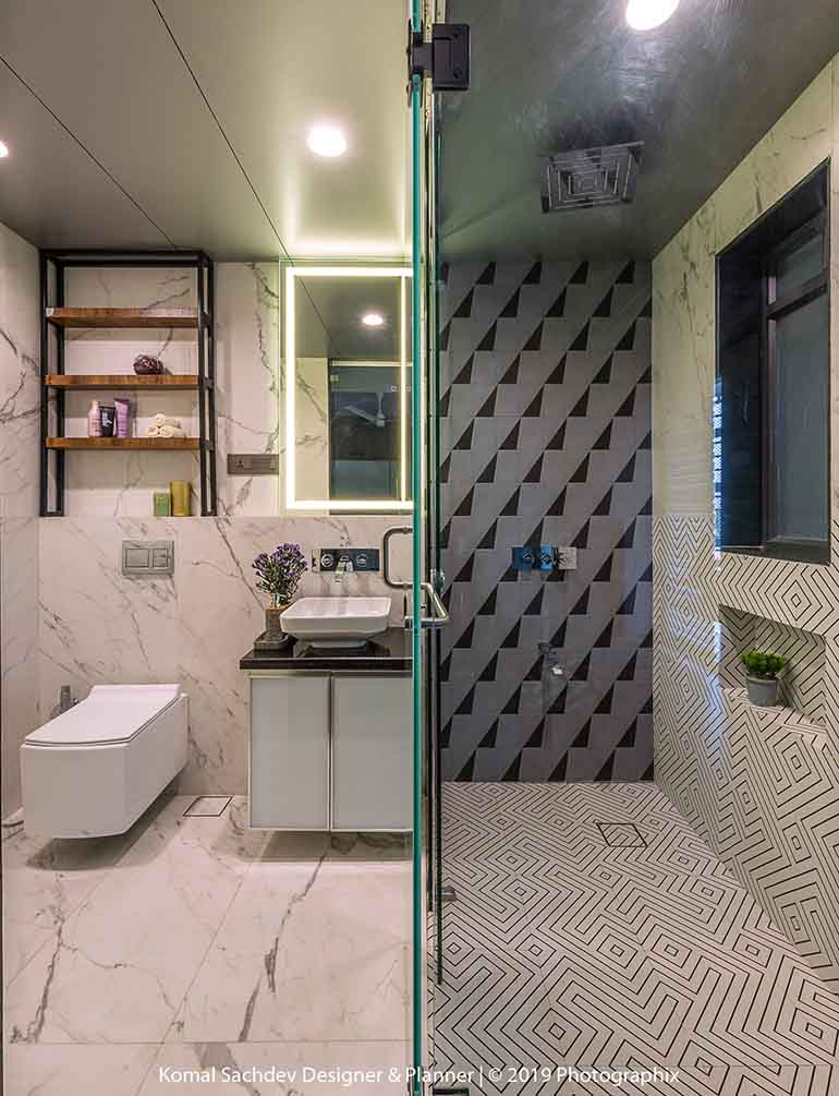 Two room house design: Quadrilateral block tiles in the bathroom.