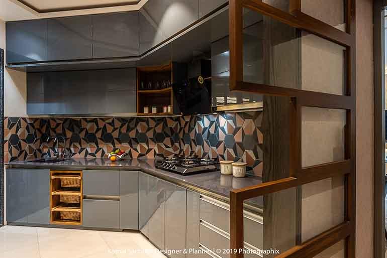 Hexagonal tiles for backsplash in this angular kitchen.