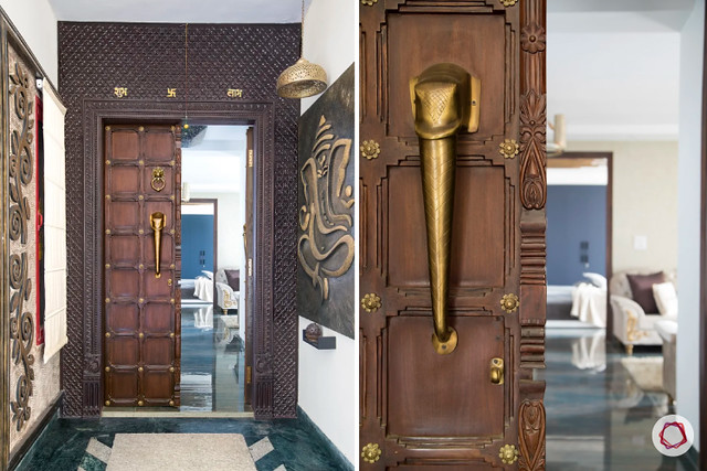 A wooden double door main door design with antique handle and Ganesha mural at the entrance of an Indian home.