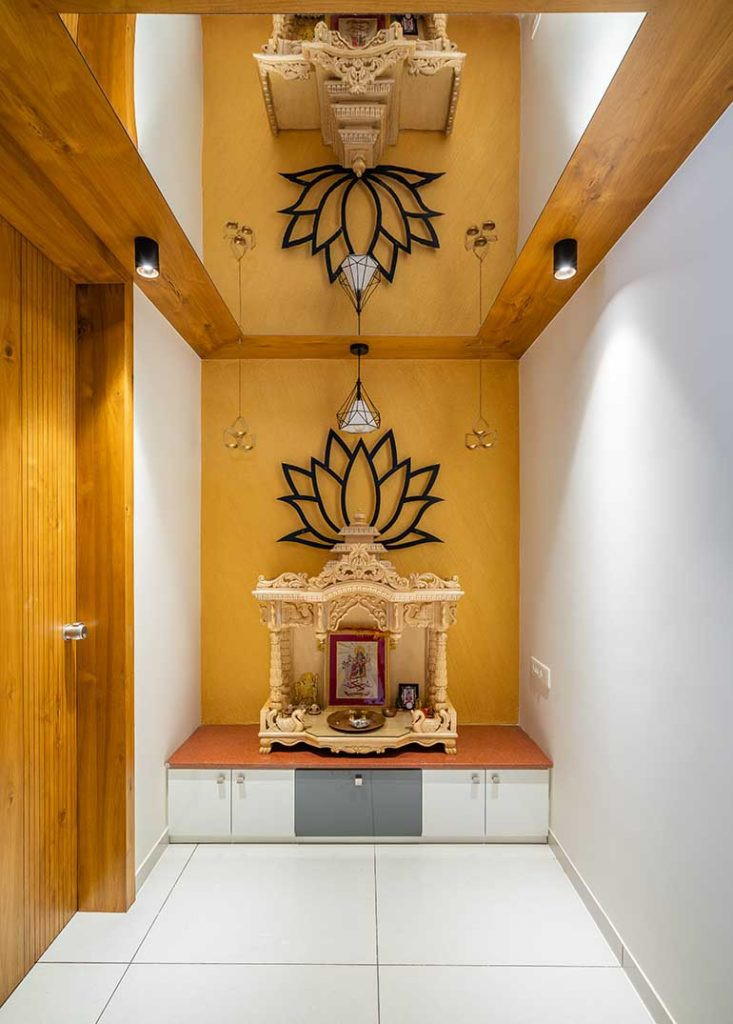 Pooja Room with Mirror Ceiling that gives the illusion of a double height space.