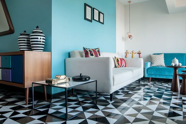 What a fun living room with patterned tiles, playful and colorful flooring .