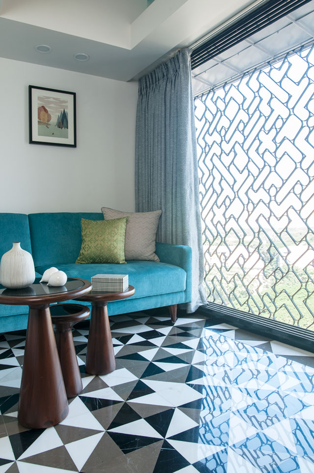 This Mumbai apartment has breezy blue walls and gray furnishings.