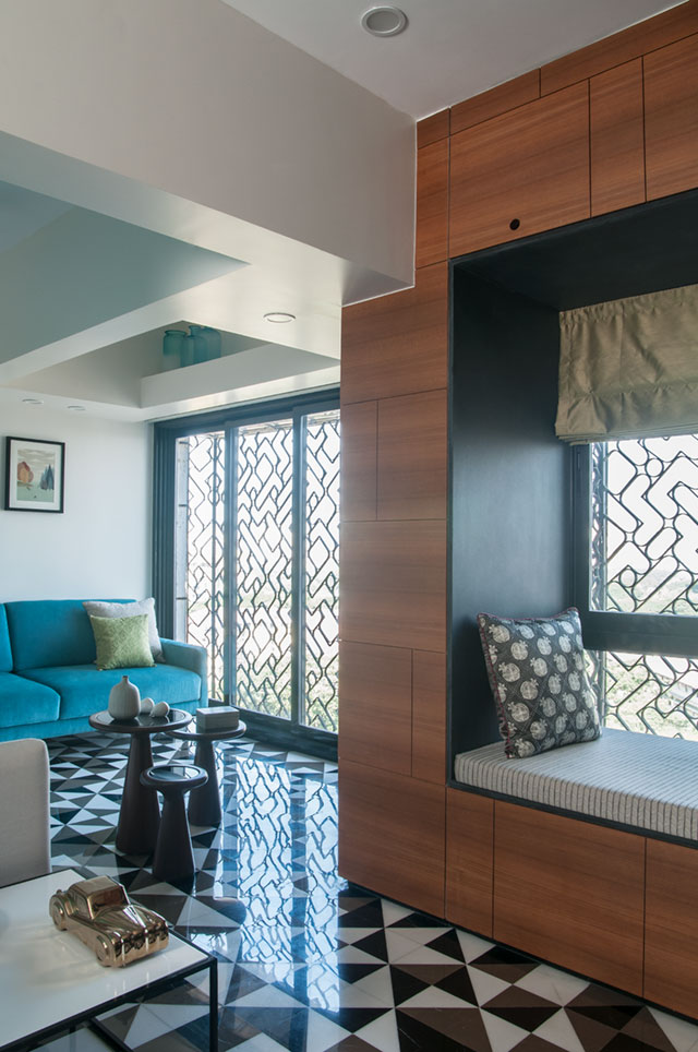 A reading nook in teak veneer finish with concealed storage