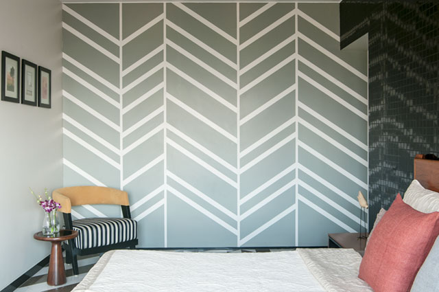 Geometric painted wall in a simple and minimal bedroom