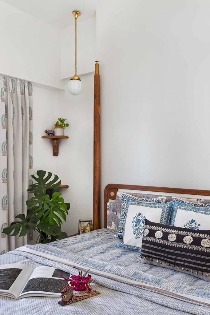 The bedroom is furnished with block printed textiles and decorated with plants in a barni. It has the characteristic Indian imprint in its decor.
